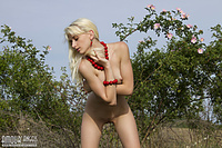 Naked blondie in nature