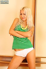 Awesome blond teen posing