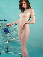 Teen model stripping and posing nude with a shopping-cart showing her rich fantasy world