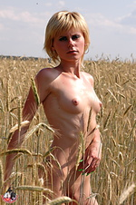 Russian beauty walks in the fields.
